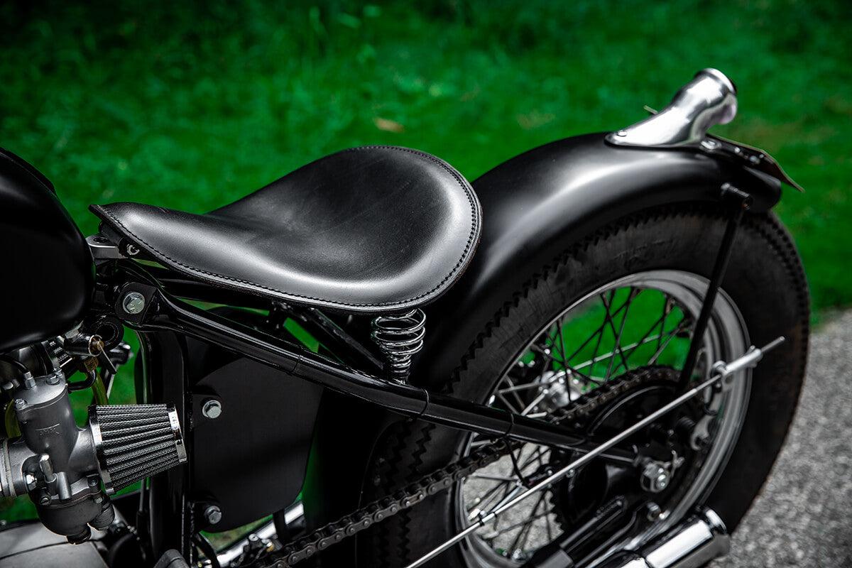 A Lowbrow Customs Bolt-On Solo Seat Pivot for 1963-1970 Triumph motorcycles.
