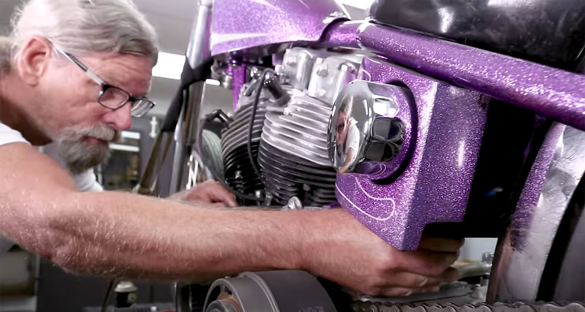 Adjusting the Harley Shovelhead clutch cable adjuster near the clutch release arm.