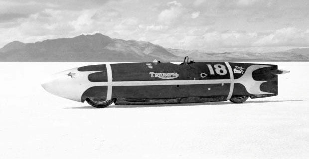 """Johnny Allen riding """"The Devils Arrow"""" broke the overall fastest motorcycle record by flying down the Bonneville Salt Flats at 193.7 mph in 1955. The Stream liner was 15.7 foot-long and powered by a methanol burning, 1950 Triumph Thunderbird 650 twin motor. Lowbrow Customs, The History of Triumph Motorcycles"""