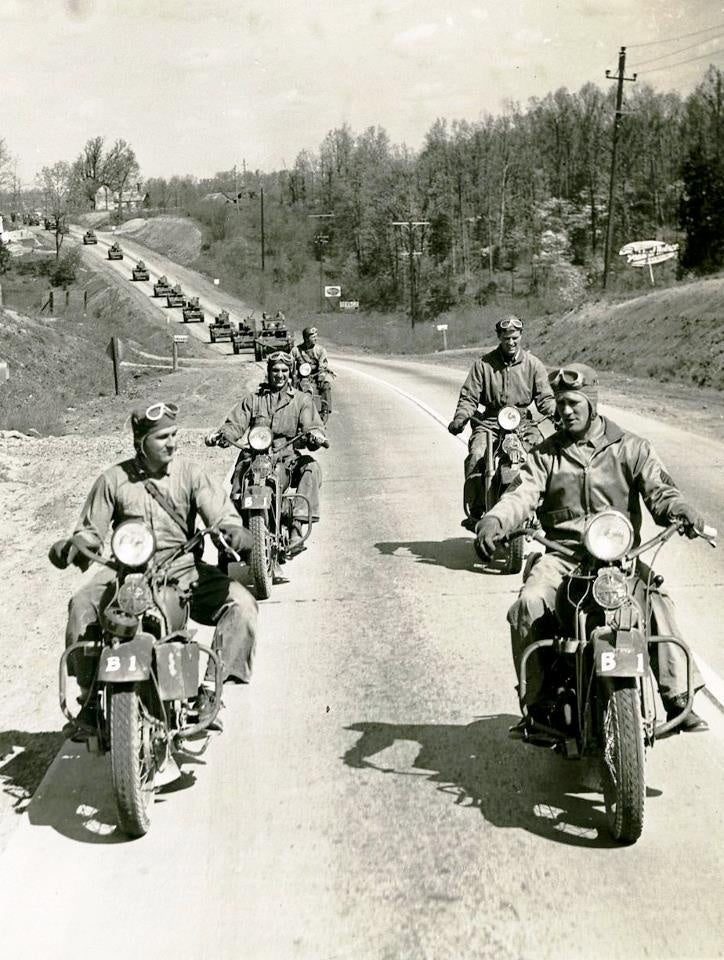 Motorcycles generally lead the pack in a military convo during World War II
