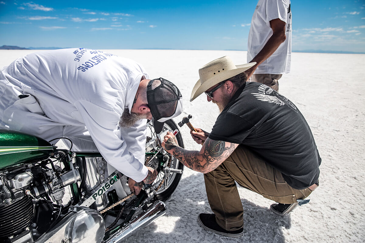 The wheel was cocked to the left and the chain hanging off, Kyle and Joe hurried to get the master link off the chain so the bike will roll freely into the chase van. - Bonneville Speed Week 2017 - Lowbrow Customs
