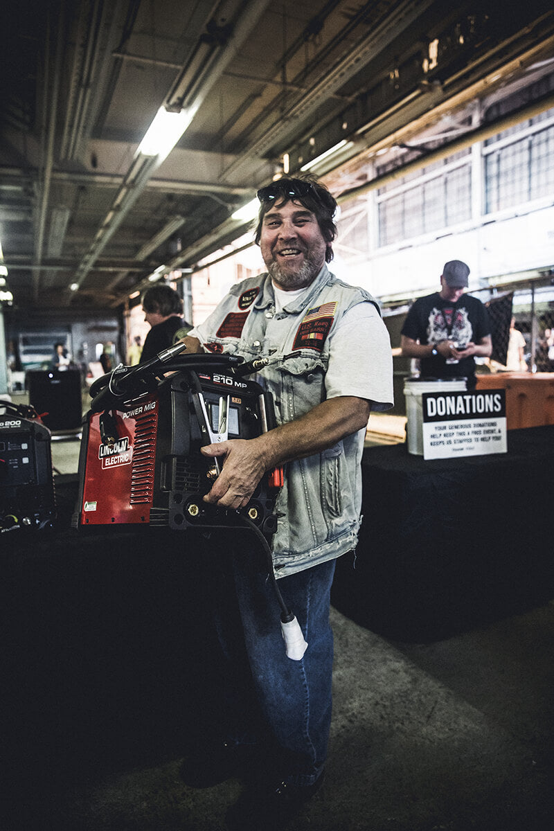 Jeff got a call while he was in the parking lot that he won a Lincoln Electric Mig Welder. He couldn't believe it! Fuel Cleveland 2017 - Lowbrow Customs, The Gasbox, Forever The Chaos Life