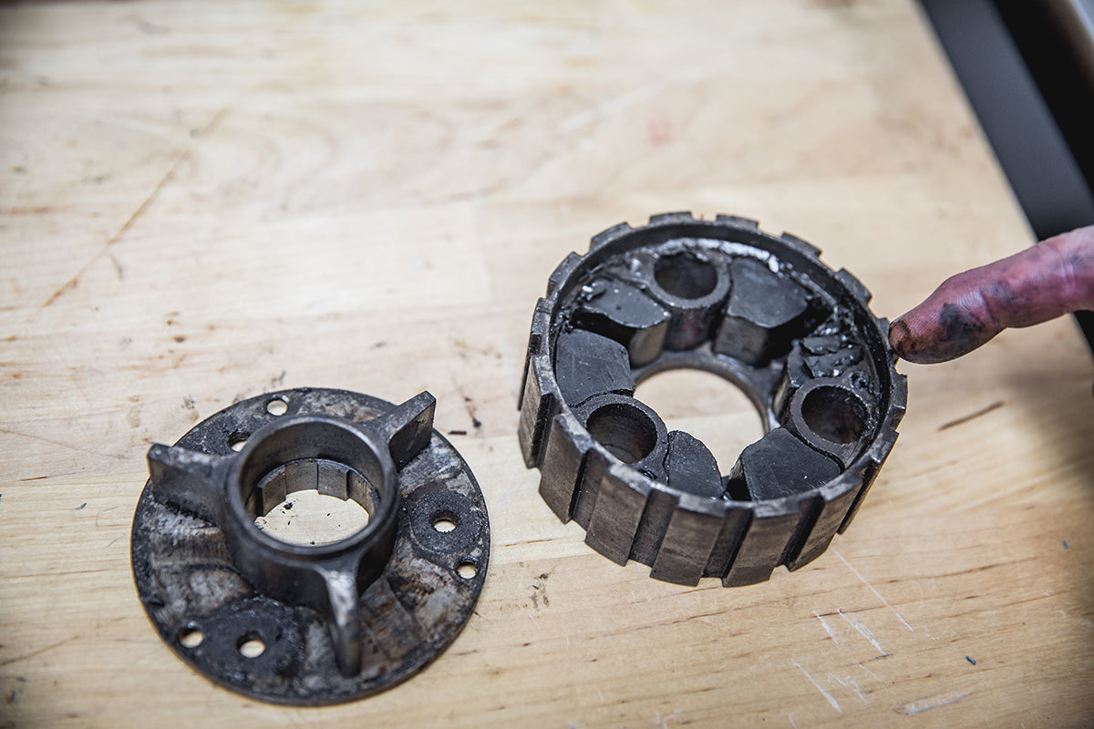The clutch center hub has three screws that you can remove to inspect the rubbers inside. If they looked damged like this one in the above picture, we recommend to replace the rubbers. Triumph 650 clutch inspection and service-Triumph 650 Clutch Inspection and Service-17