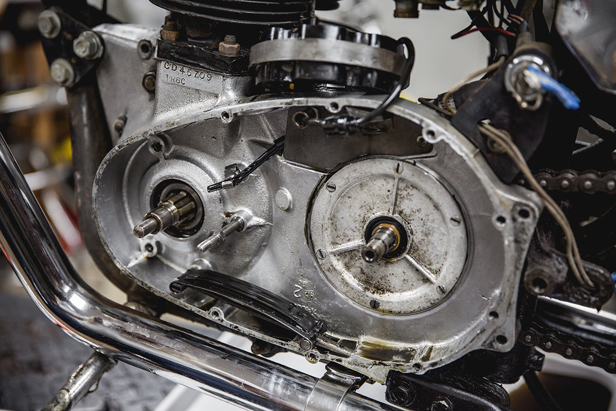 Notice the 6 flat head screw where the clutch basket was located. Remove that cover to inspect the transmission drive sprocket. Triumph 650 clutch inspection and service-Triumph 650 Clutch Inspection and Service-16