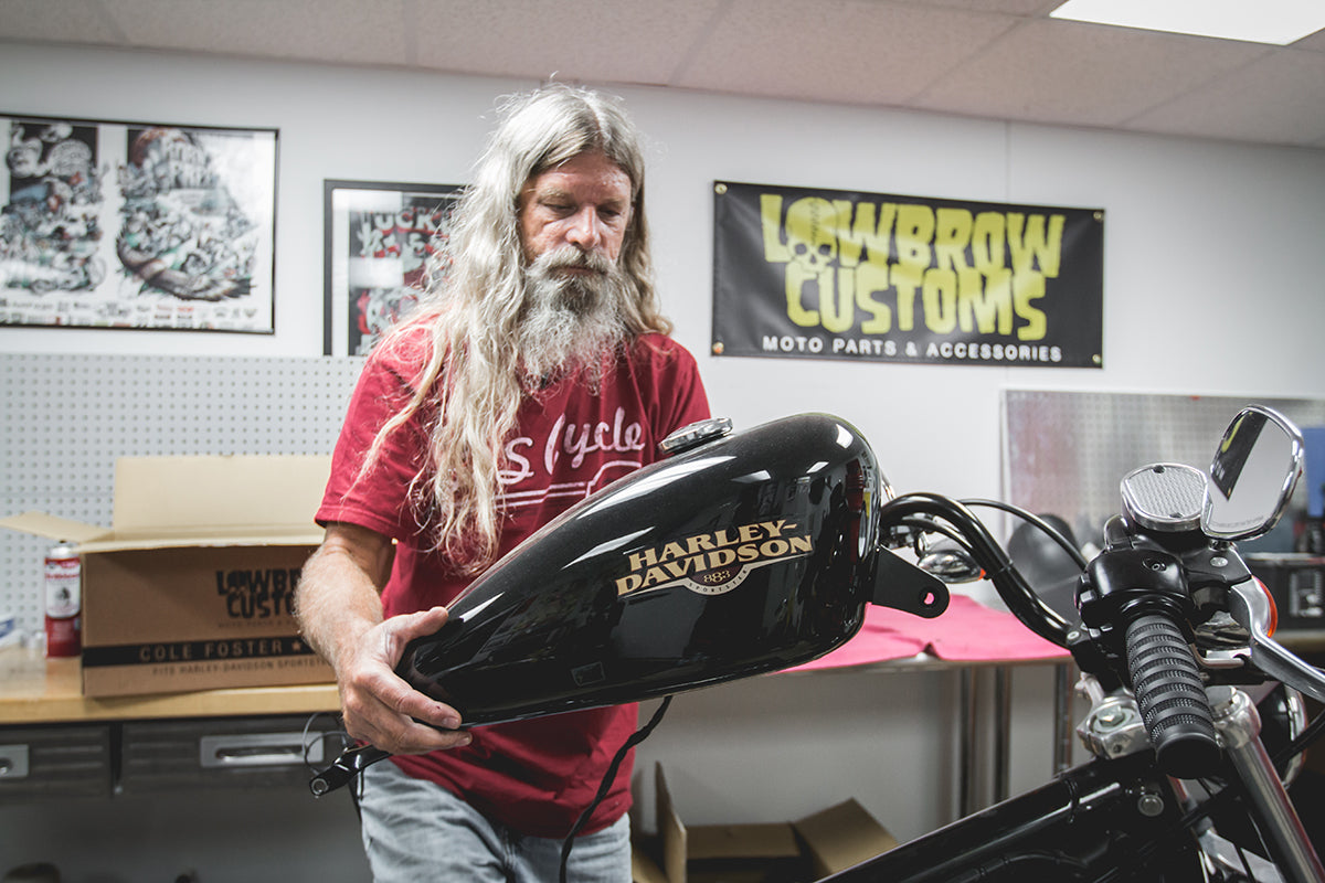 Todd removing the gas tank from the bike. Lowbrow-Customs-Cole-Foster-Gas-Tank-How-to-Install-4720