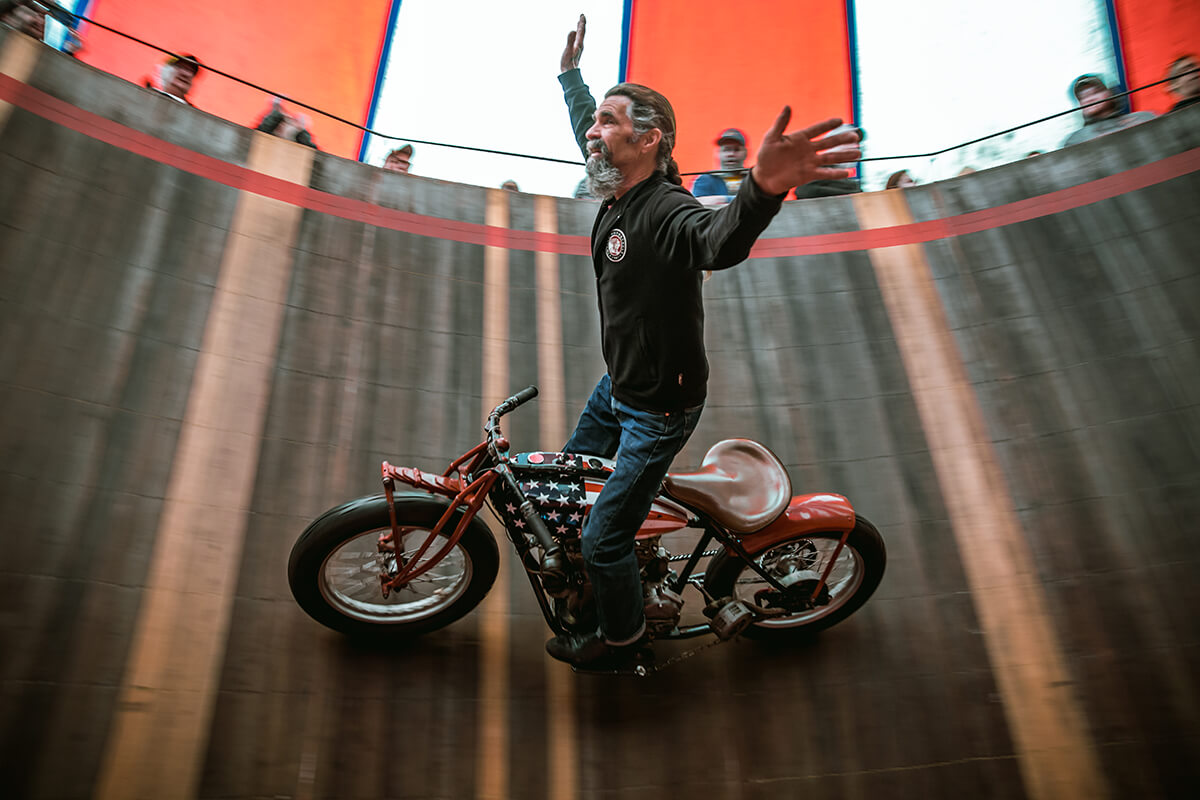 Charlie Ransom standing and no hands on the American Wall of Death. - Lowbrow Customs - Cycle Showcase 2017 - St. Louis