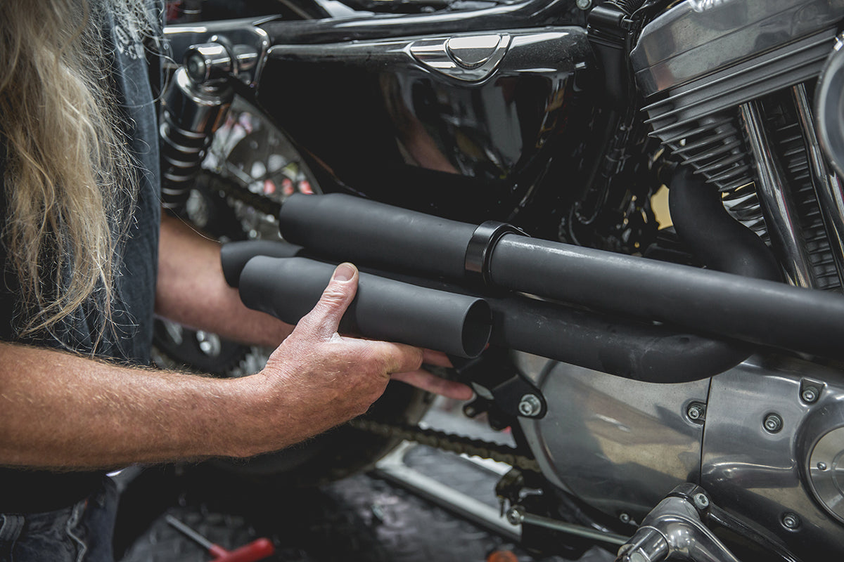 Todd lining up the second Mini Muffler to where he wants to mount it, and marking it to be cut. Lowbrow-Customs-Cycle-Source-techtip-install-biltwell-mini-mufflers-6091