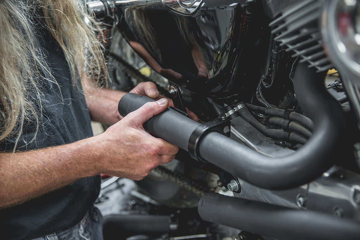 Todd loosely attaching the Mini Muffler to the rear pipe and bracket. Lowbrow-Customs-Cycle-Source-techtip-install-biltwell-mini-mufflers-6139