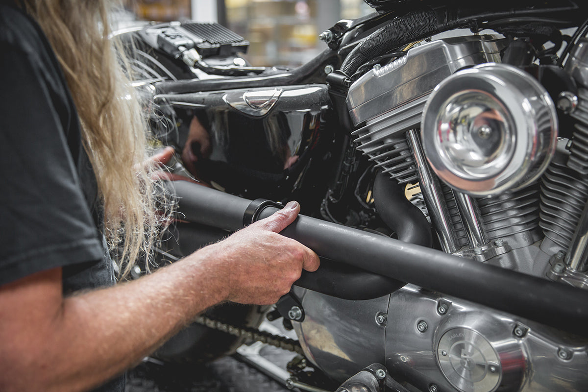 By loosely installing both pipes, it makes for an easier time to line up the pipes evenly. Lowbrow-Customs-Cycle-Source-techtip-install-biltwell-mini-mufflers