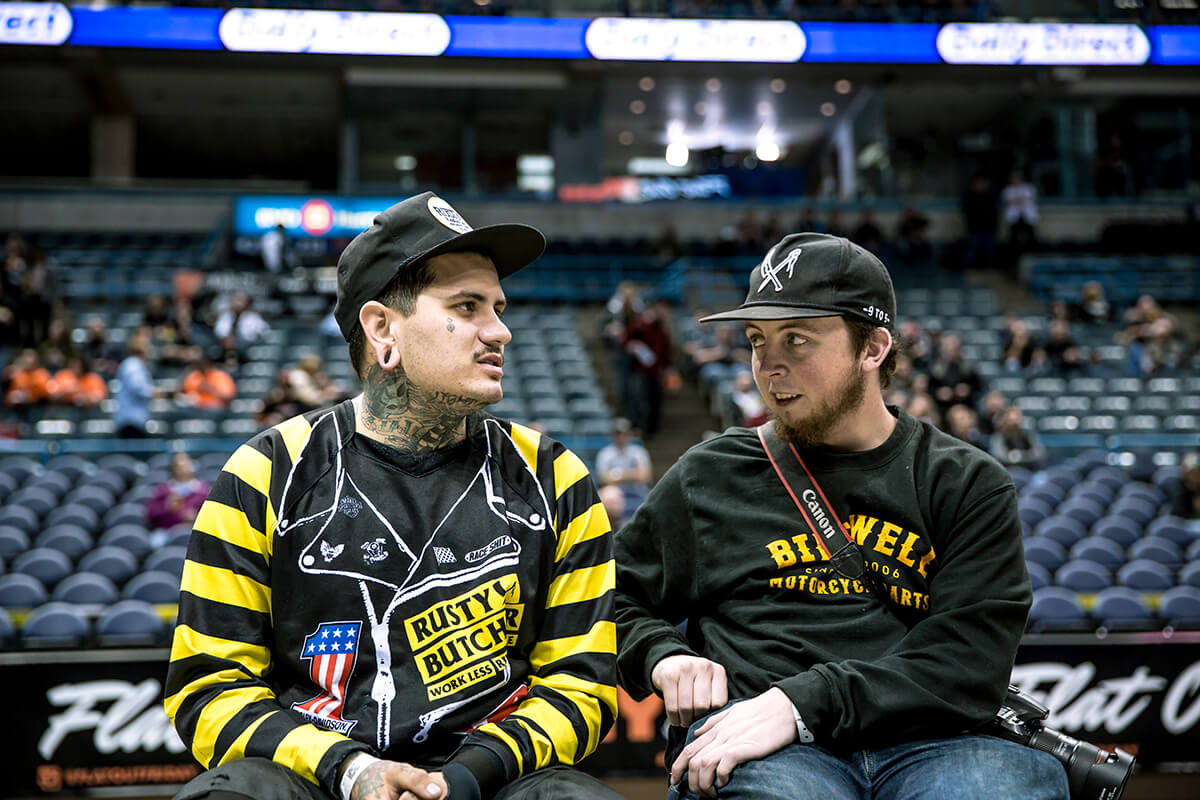 """Mark """"Rusty Butcher"""" Atkins and Flynn Bryant discussing if they should take a siesta under the Flat Out Friday signs. - Lowbrow Customs - Mama Tried 2017"""