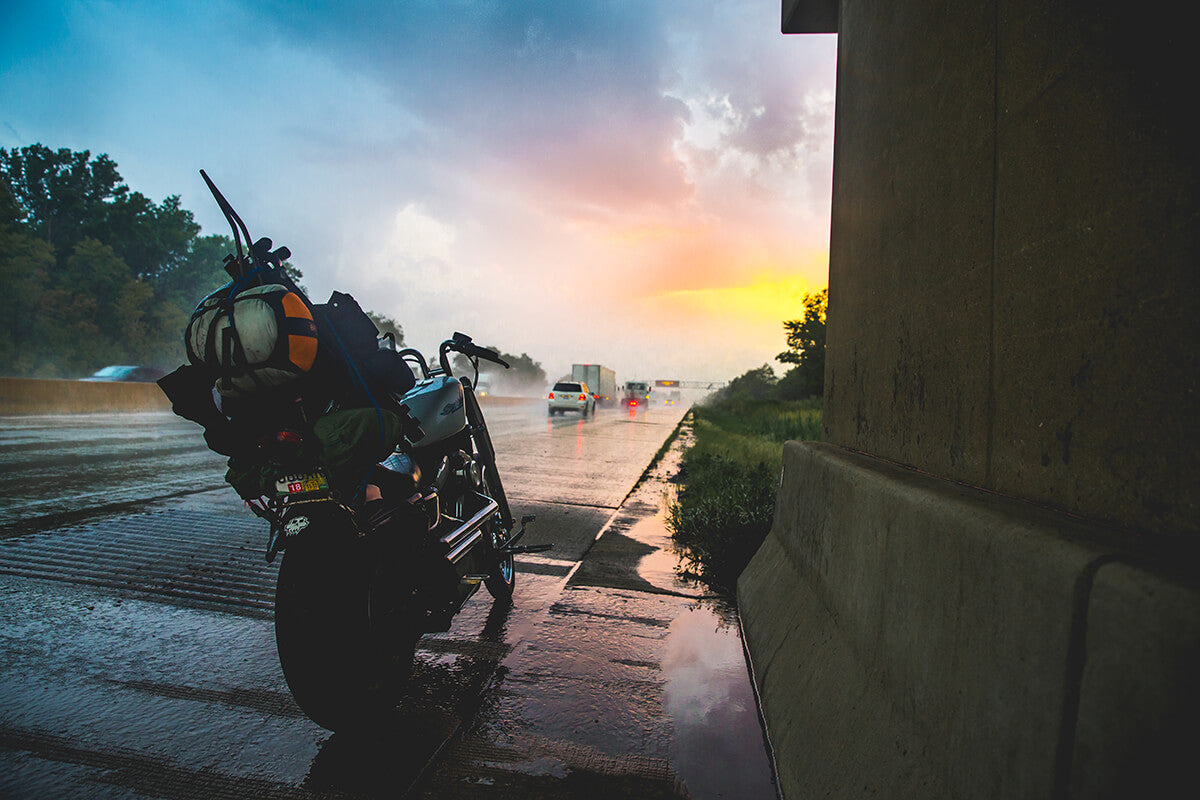 No front fender and heavy rains, followed by epic sunsets and endless colors. This was one of my favorite moments from the first day of travel, wet, cold, tired but in awe on how beautiful the sky was. - Lowbrow Customs - Sturgis 2017