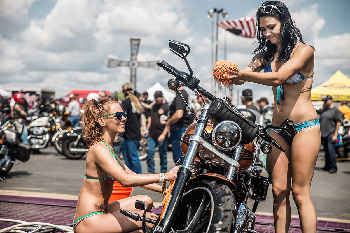 "For $20 you could get your ""hog"" washed by some bikini babes, not that most of the bikes in attendance actually needed to be washed or anything. Lowbrow Customs - Sturgis 2017"