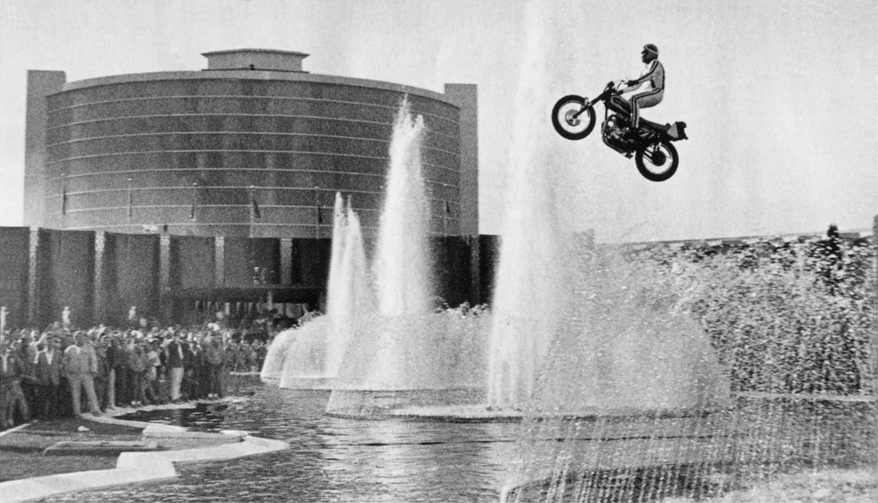 Evel Knievel's jump at Caesars Palace in Las Vegas, NV 1967. If you didn't know, it ended terribly with over 40 bones broken in the crash landing. Lowbrow Customs - The history of Bell Helmets Evel-Knievel-1967 -famous-Caesars-Palace-jump