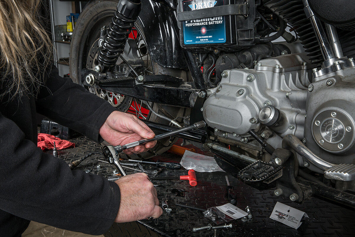 Tighten down the mounting bracket, make sure to use the spacers provided in between the bracket and transmission case. - Lowbrow Customs - 2 into 1 by Kerker How to Install on Dyna