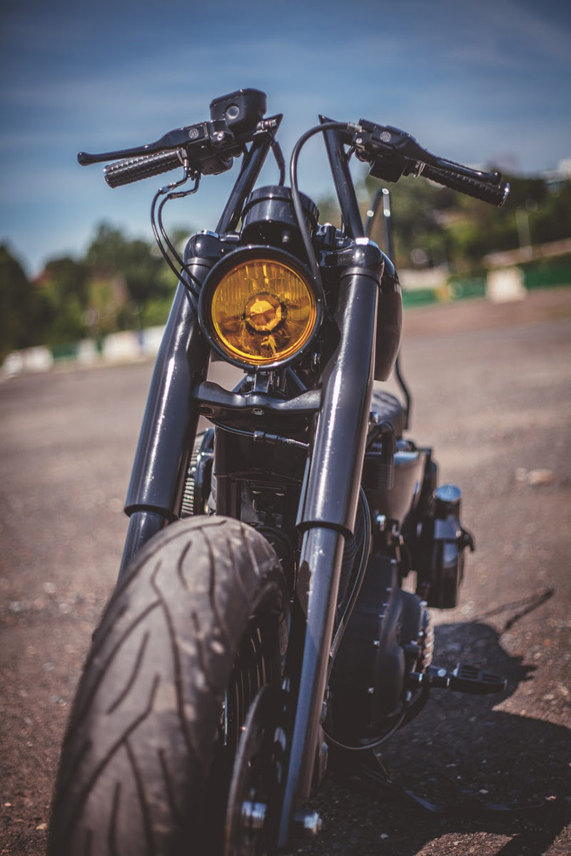 Zach's Sportster features our Lowbrow Customs Fork Shrouds in black.