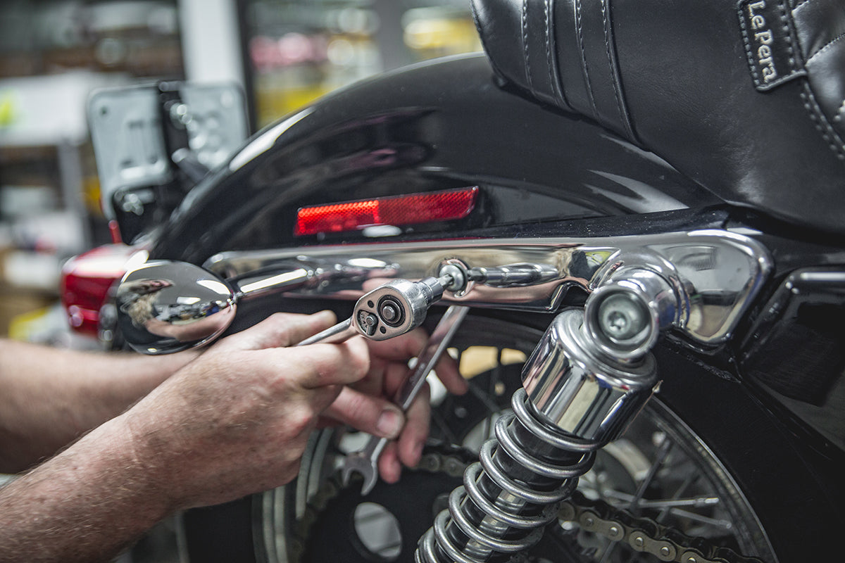 Todd Removing all 4 strut bolts. - How to install Gasbox Sissy Bar on a Sportster
