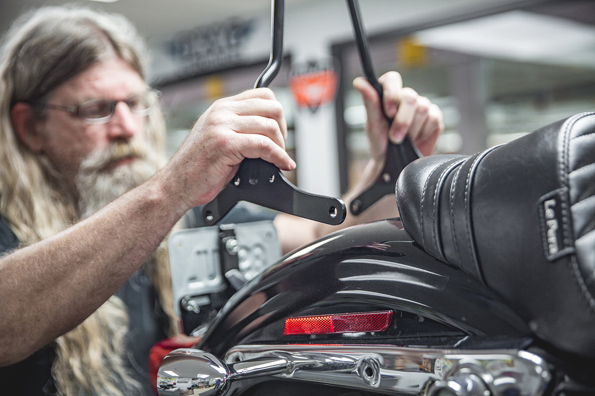 Todd going front to back aligning the holes. -  How to install Gasbox Sissy Bar on a Sportster