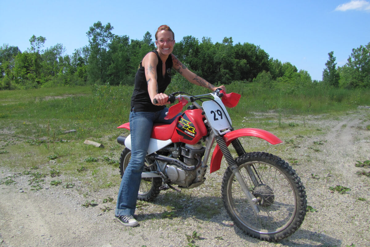 Katy on her dirt bike for a lunch time or after work ride on the property.