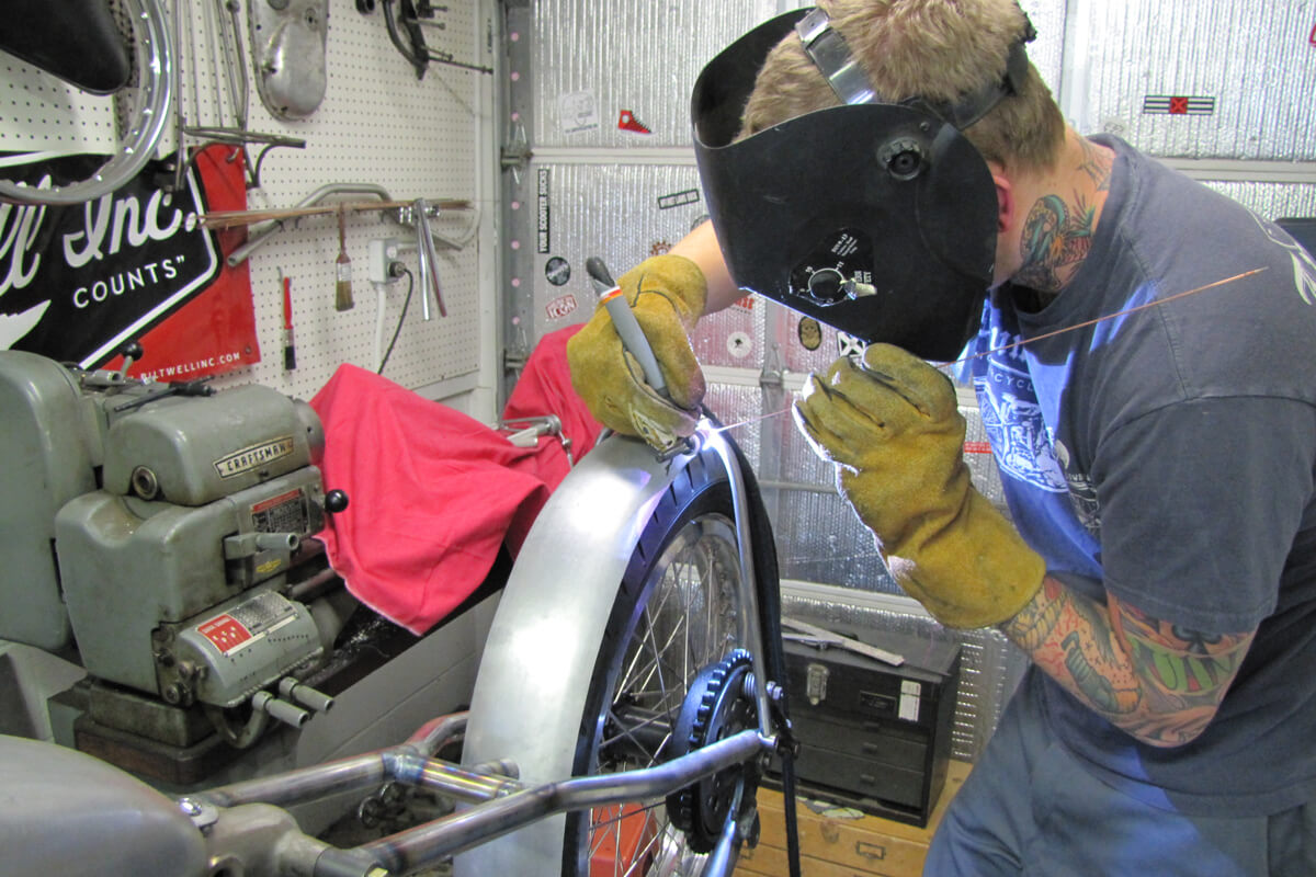 Welding up a DIY Fender Strut Kit on Poison Ivy back in the day.