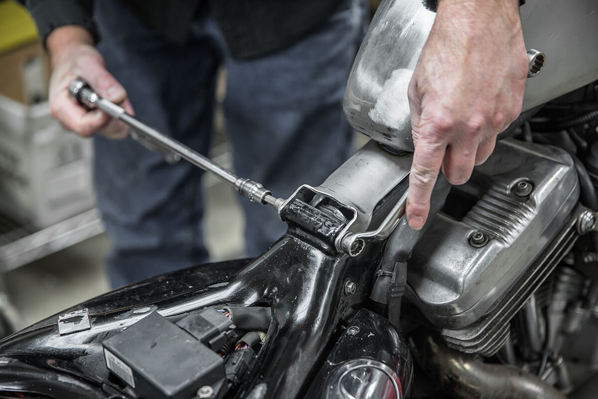 Securely tighten down the back bolt. How to install: Cycle Standard Blackbird Gas tanks - Lowbrow Customs