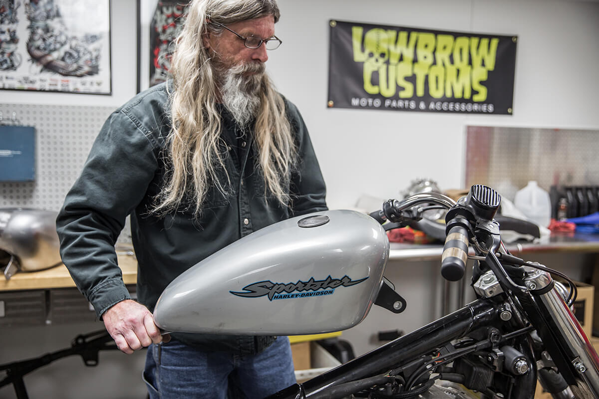 Todd removing the old generic stock tank off.  How to install: Cycle Standard Blackbird Gas tanks - Lowbrow Customs