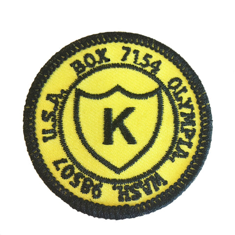 K Postal Merit Badge