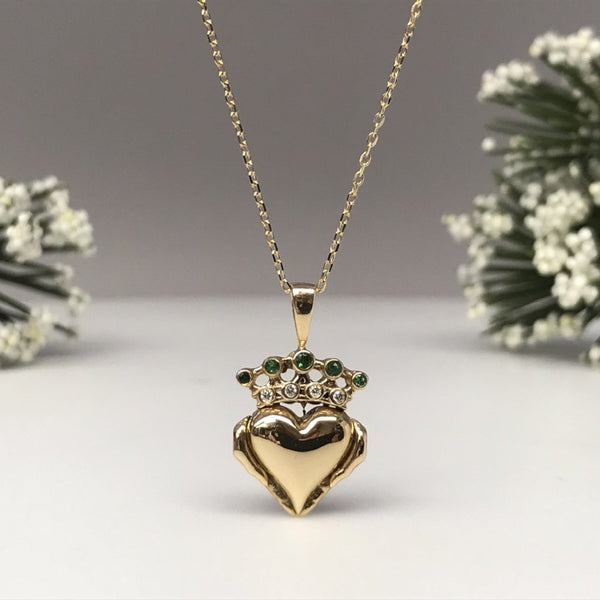 Irish Claddagh pendant necklace with green and white gemstones