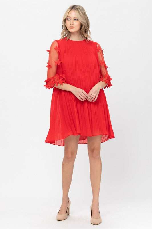 Pleated dress with floral detailed sleeves