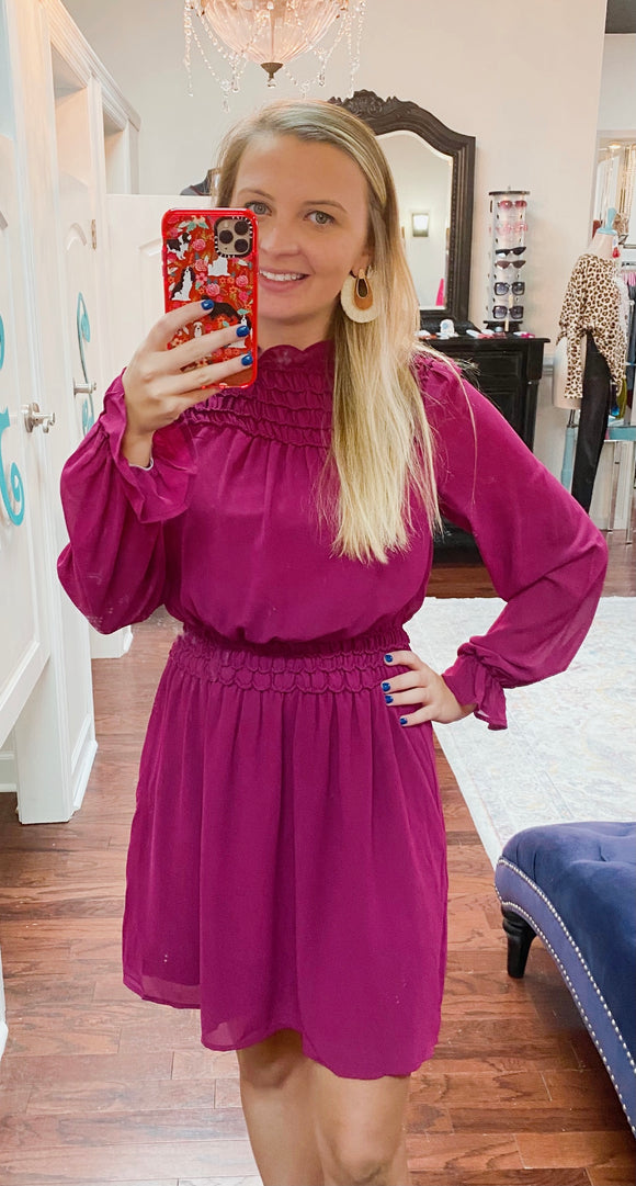 Magenta long sleeve smocked dress
