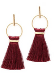 Tassel and gold hoop earring