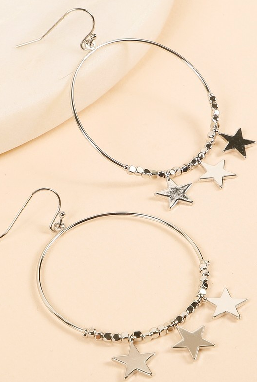 Round metal earrings with stars