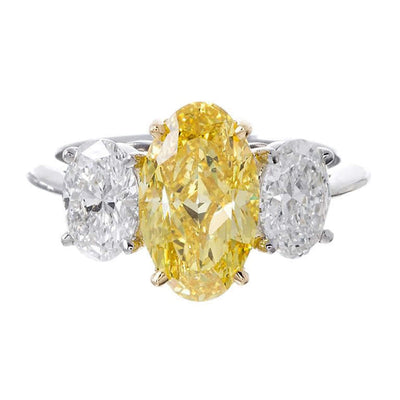 fancy yellow oval cut diamond three stone ring