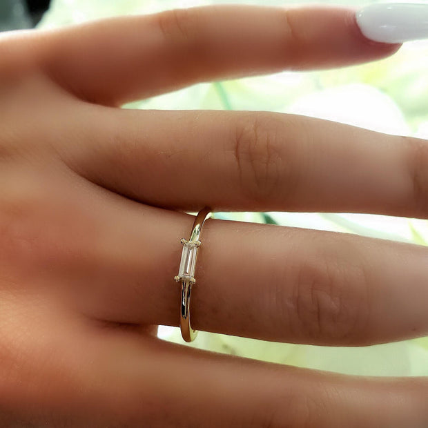 small baguette diamond ring with yellow gold band