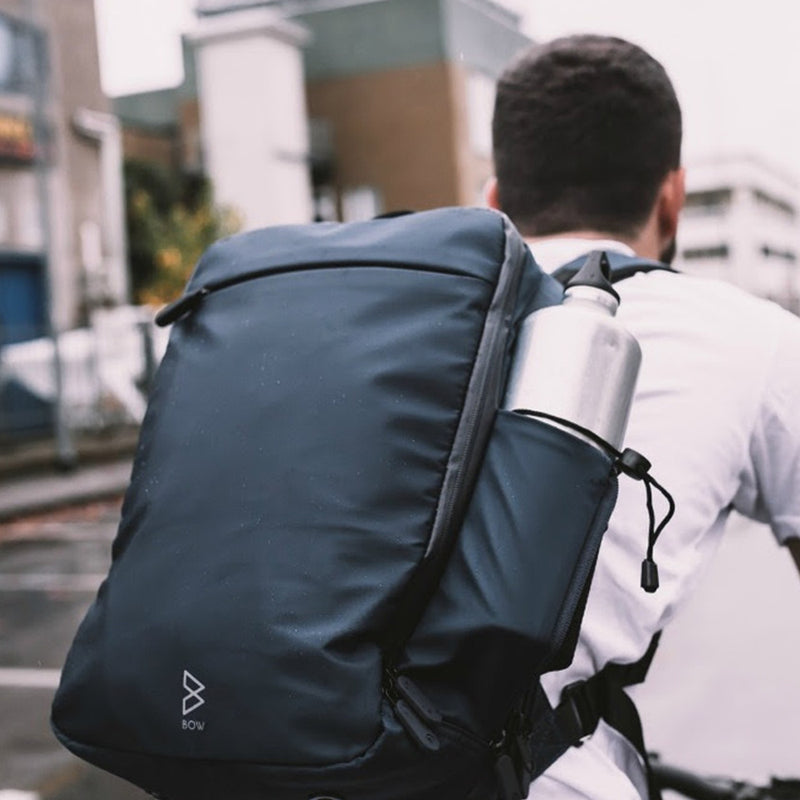 Quiver X Multifunctional Bag - 3-in-1 Everyday Carry outdoor use carried by a man