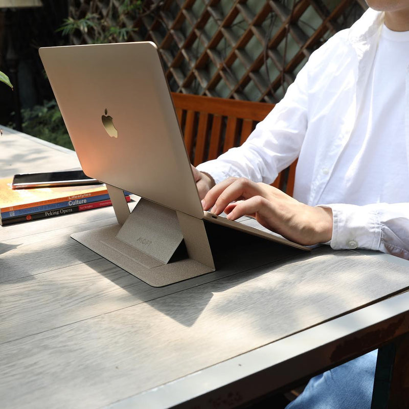 MOFT Laptop Stand – Invisible, Lightweight & Adjustable in use by woman on laptop