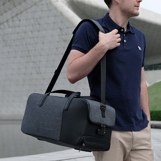 Flexpack Go by Korin - Functional Anti-Theft Duffle Bag on the go carried by a man