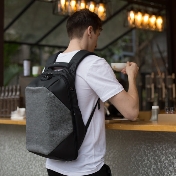 ClickPack Pro by Korin - Slash Proof, Anti-Theft Backpack carried by man outdoors