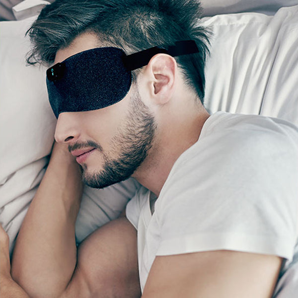 SleepMagic - Smart Anti-Snoring Eye Mask + Sleep Data, SleepMagic eye mask used by a sleeping man