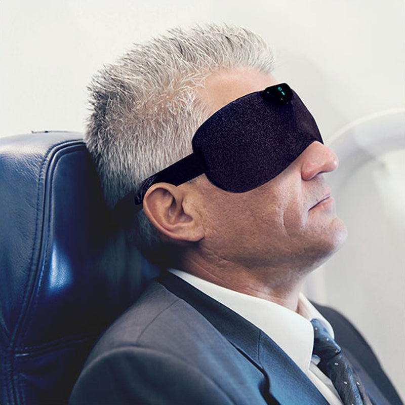 SleepMagic - Smart Anti-Snoring Eye Mask + Sleep Data, man using SleepMagic eye mask while traveling