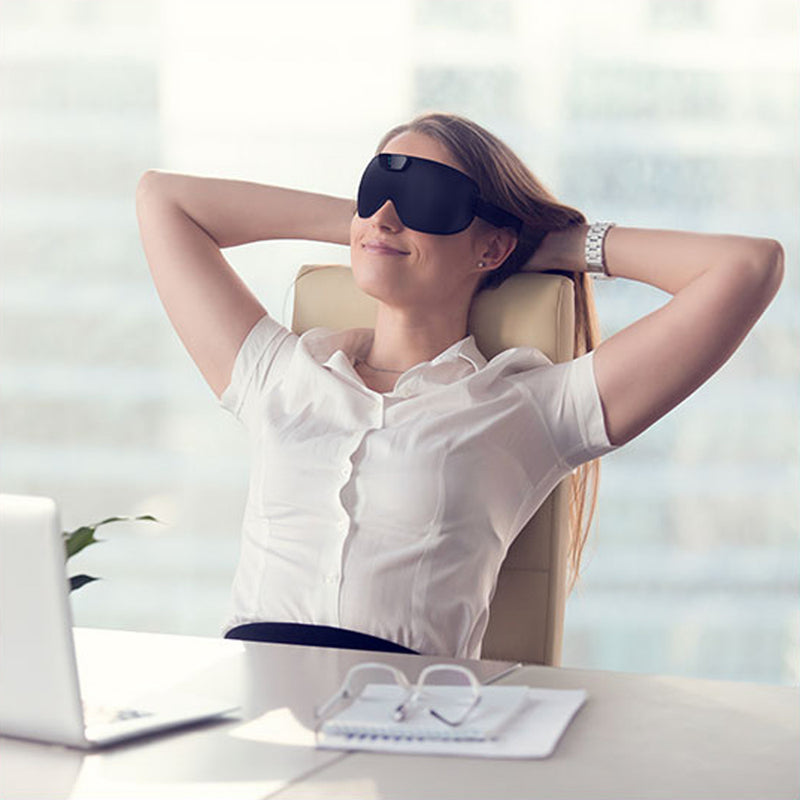 SleepMagic - Smart Anti-Snoring Eye Mask + Sleep Data, woman using SleepMagic eye mask at work desk