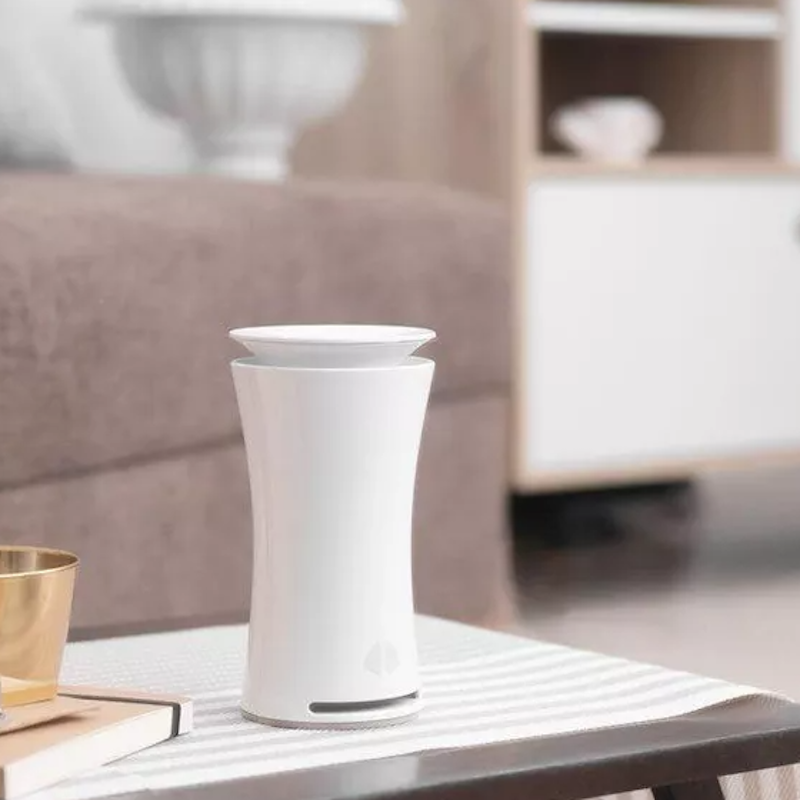 uHoo Indoor Air Sensor – Tracks Nine Air Quality Factors - placed on living room table