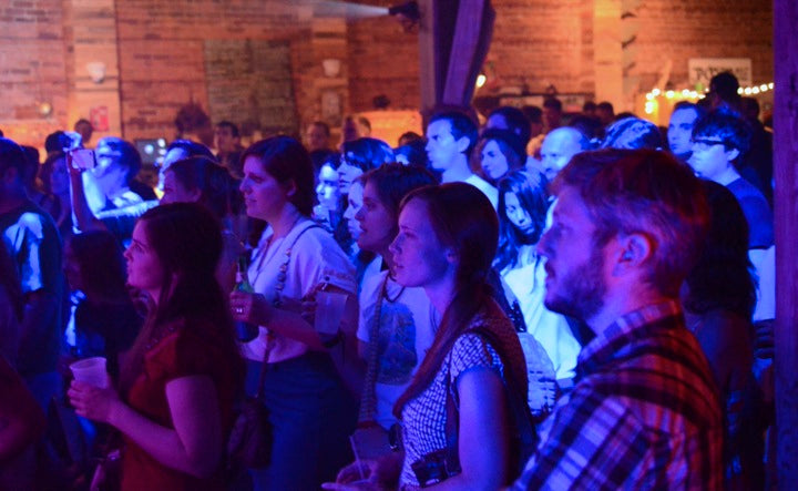 The crowd at Underbelly watches local artists play their favorite Bob Dylan songs.