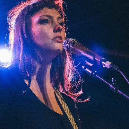 Angel Olsen in her Peruvian guitar strap