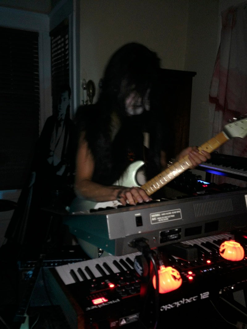 David MacNutt plays guitar and synth at the same time