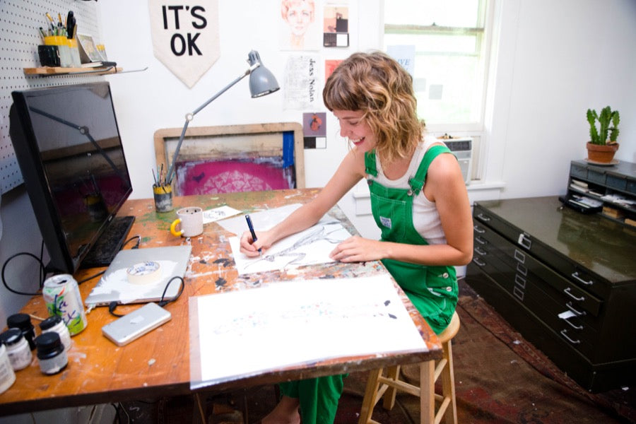 Nashville artist Emily Miller working in her studio.