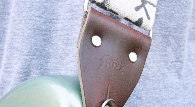 Detail of the Original Fuzz logo embossed into the leather end tab of the Indian strap