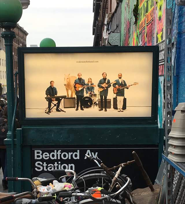 Real Esate band ad on the Bedford L train