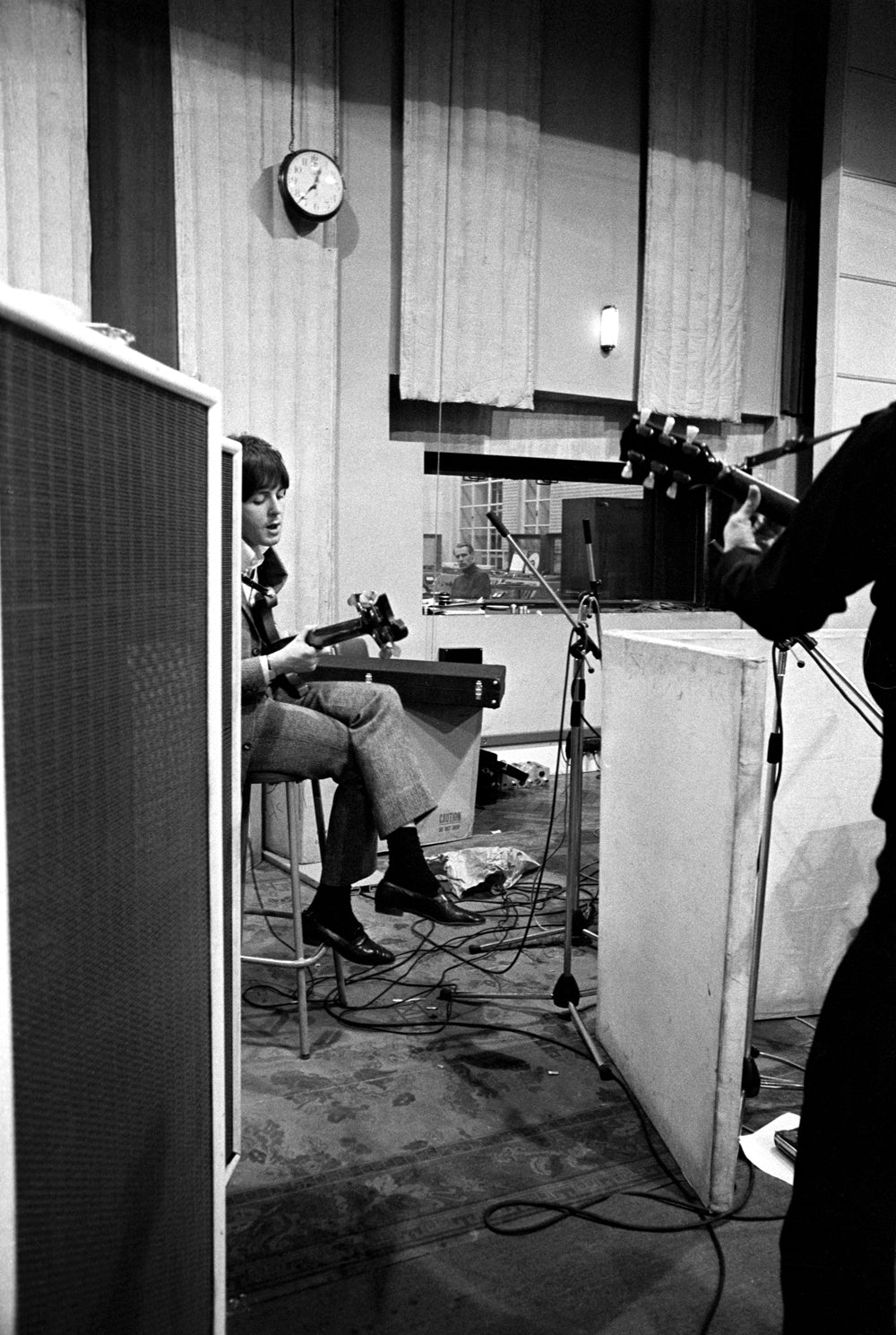 Paul McCartney recording bass during Revolver sessions as seen from George Martin's vantage point