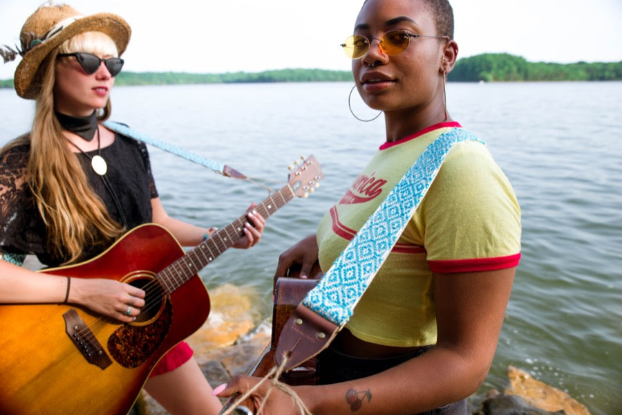 Two girls with handwoven Original Fuzz guitar strap standing by the lake in Nashville.