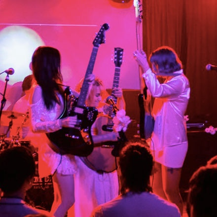 Idle Bloom performs in their Peruvian guitar straps